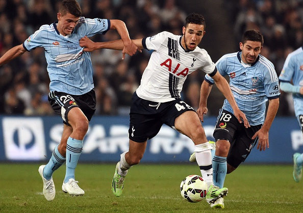 Tottenham Hotspur midfielder Nabil Bentaleb (C) is tackled by Sydney FC defenders George Blackwood (L) and Peter Triantis (R) in their friendly football match in Sydney on May 30, 2015.  AFP PHOTO/William WEST  --IMAGE RESTRICTED TO EDITORIAL USE - STRICTLY NO COMMERCIAL USE--        (Photo credit should read WILLIAM WEST/AFP/Getty Images)